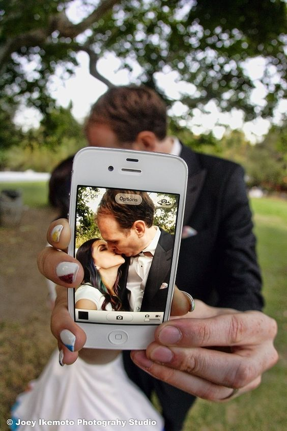 kiss selfie wedding couple