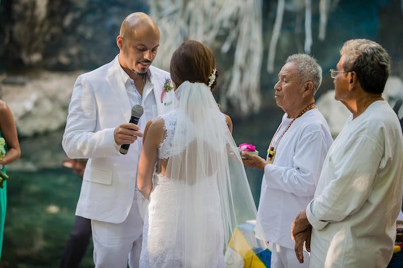 Exchange rings at Cenote Destination Wedding