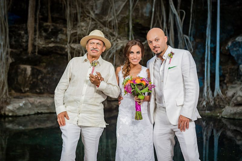bride, father-in-law and groom with their boutonnieres at cenote wedding in yucatan
