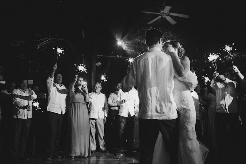 Groom wearing guayabera and dancing at his wedding