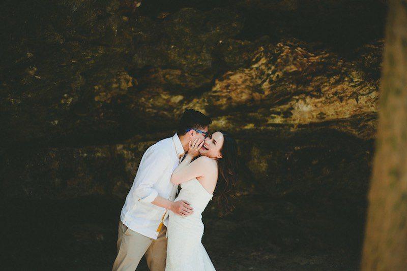 Groom wearing yucatecan guayabera kissing his bride