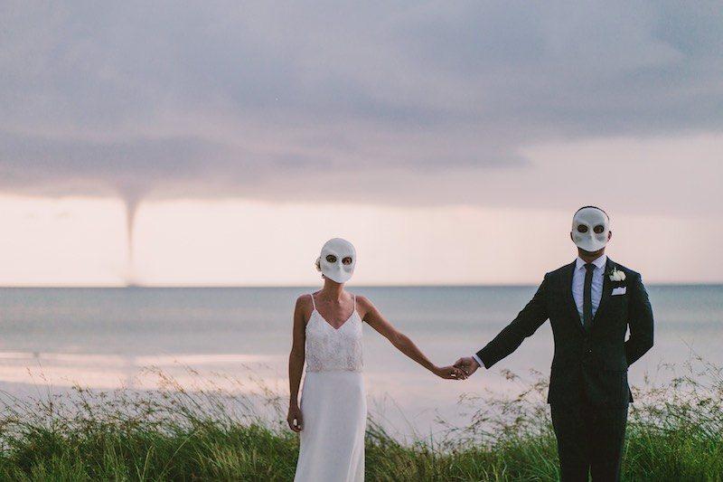 Wedding couple holding hands at Holbox Destination Wedding