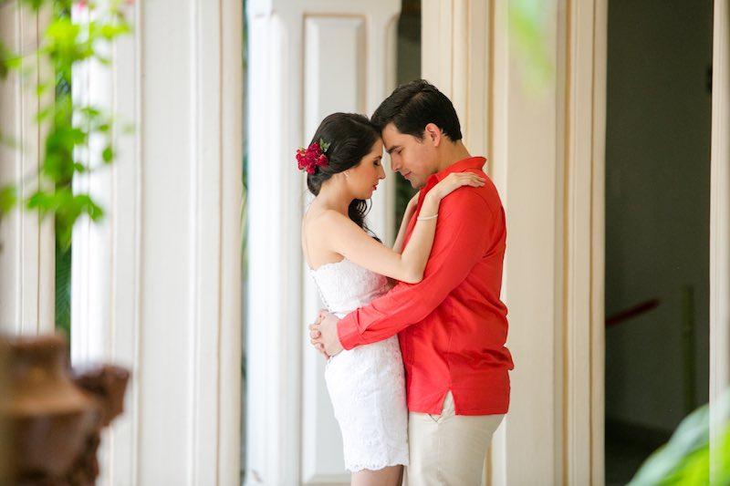 Groom's red guayabera and bride in Yucatan Destination Wedding