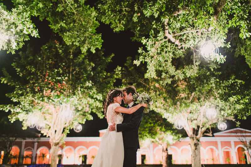 destination wedding kiss at hacienda chichi suarez in Yucatan