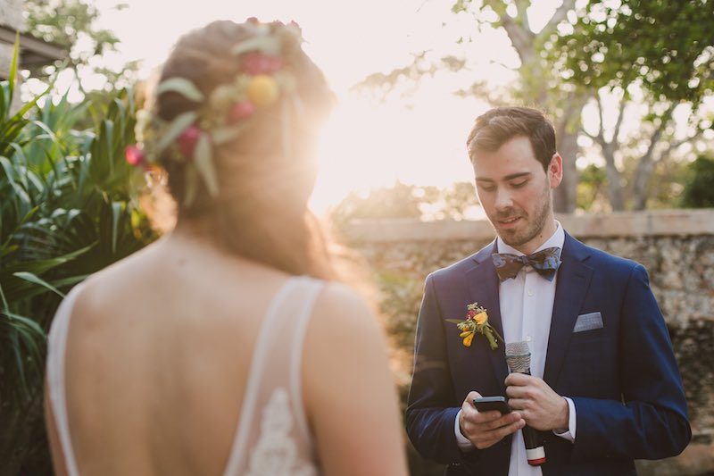 groom reading his vows at destination wedding in Yucatan