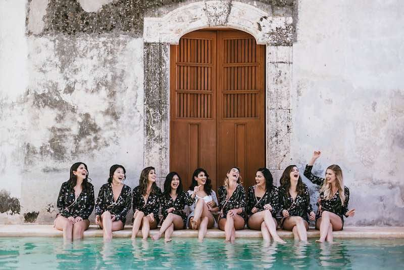 bridemaids and bride having fun by the pool at destination wedding in Yucatan