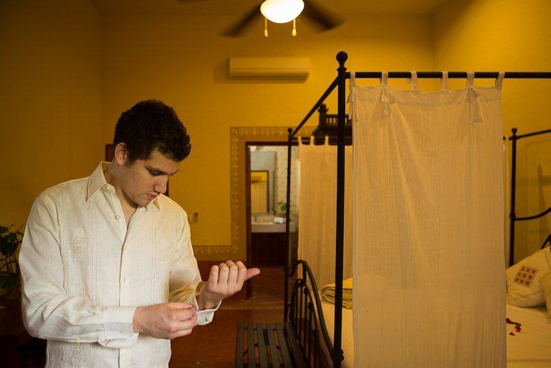 Groom getting ready wearing a guayabera