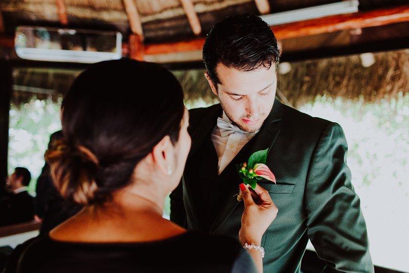 groom outfit suit flower brooch wedding