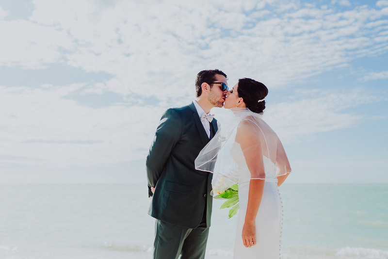 bride and groom wedding beach first look kiss