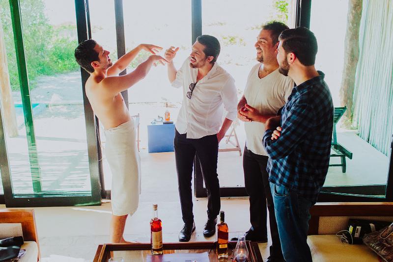 groom friends getting ready wedding beach