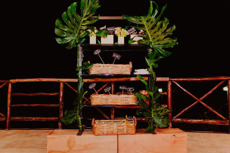 wedding furniture candy table tropical foliage