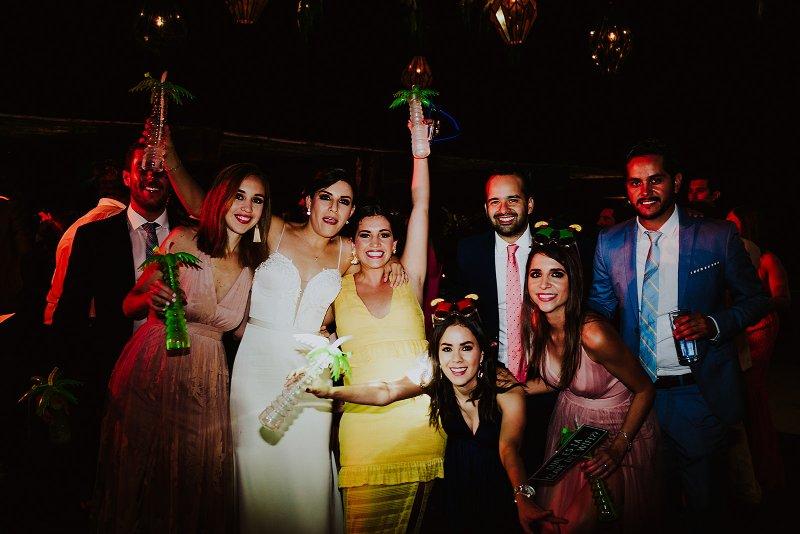 tropical wedding party bride friends