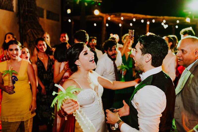tropical wedding newlyweds dancing party